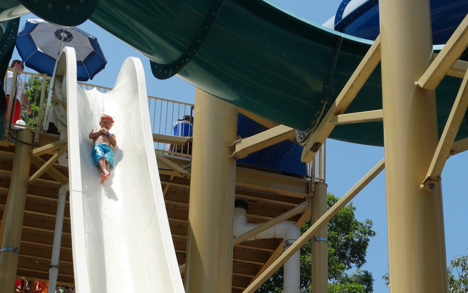 Boy going down one of the 4 water slides at Otter Creek Waterpark