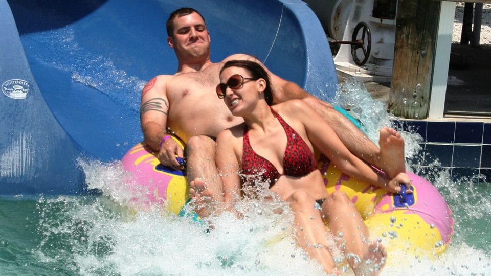 Man and Woman going down Water Slide at Discovery Island