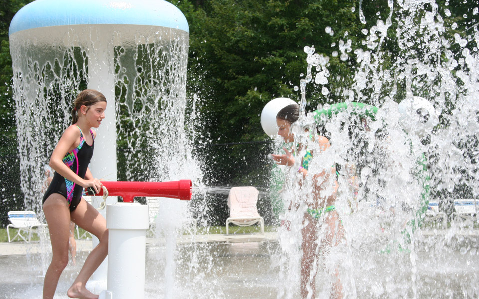 Two girls having fun in the Spray Pad at Otter Creek Waterpark